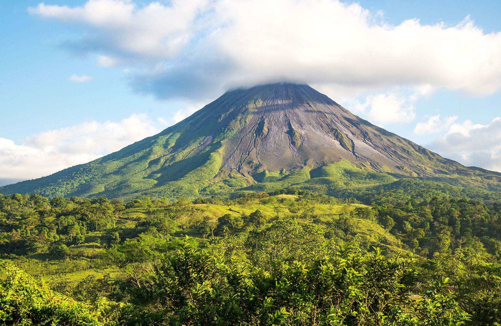 Lush green forrest and the huge Arenal volcano in Costa Rica
