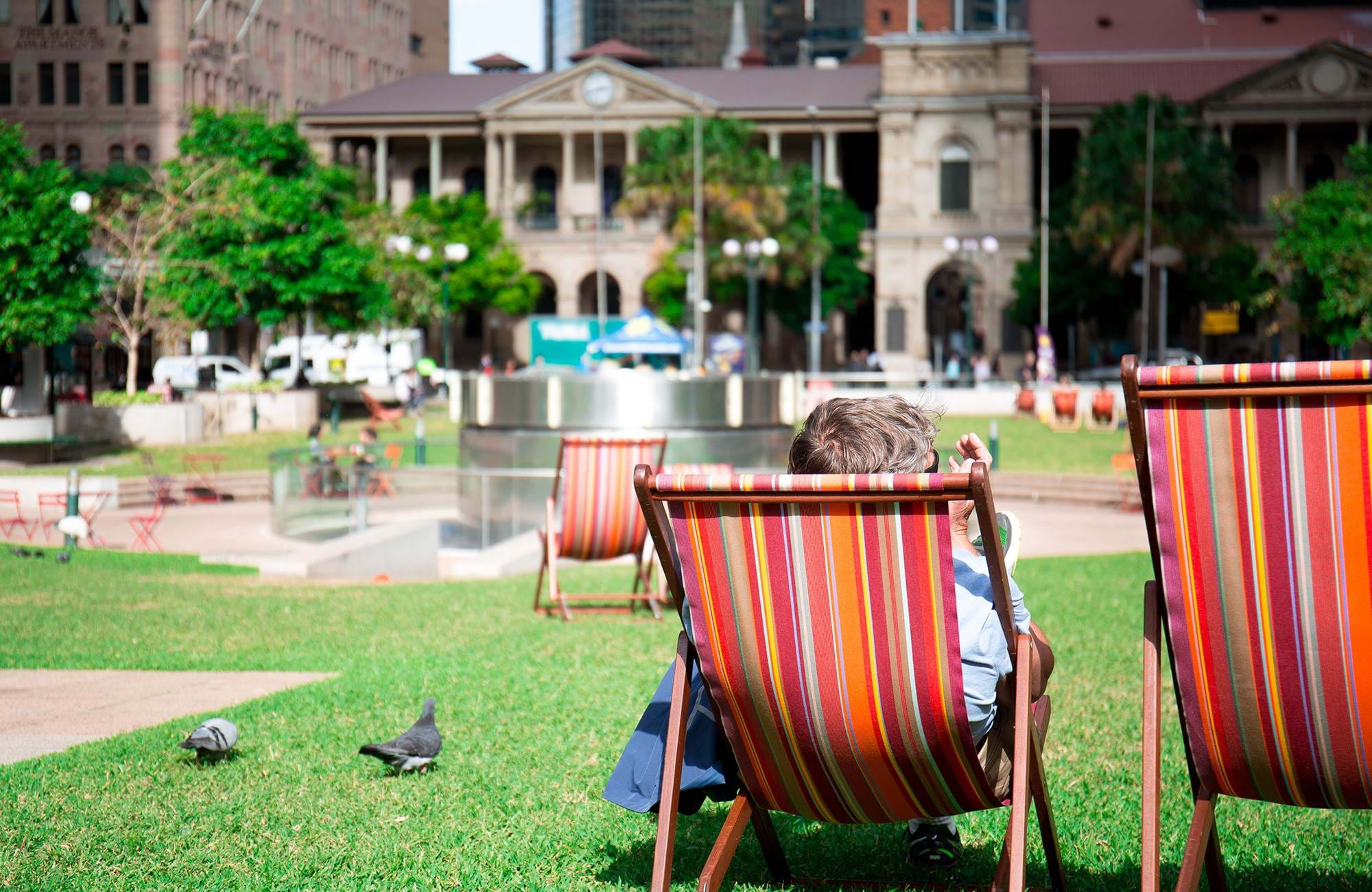 a student is chilling in a park in brisbane in australia