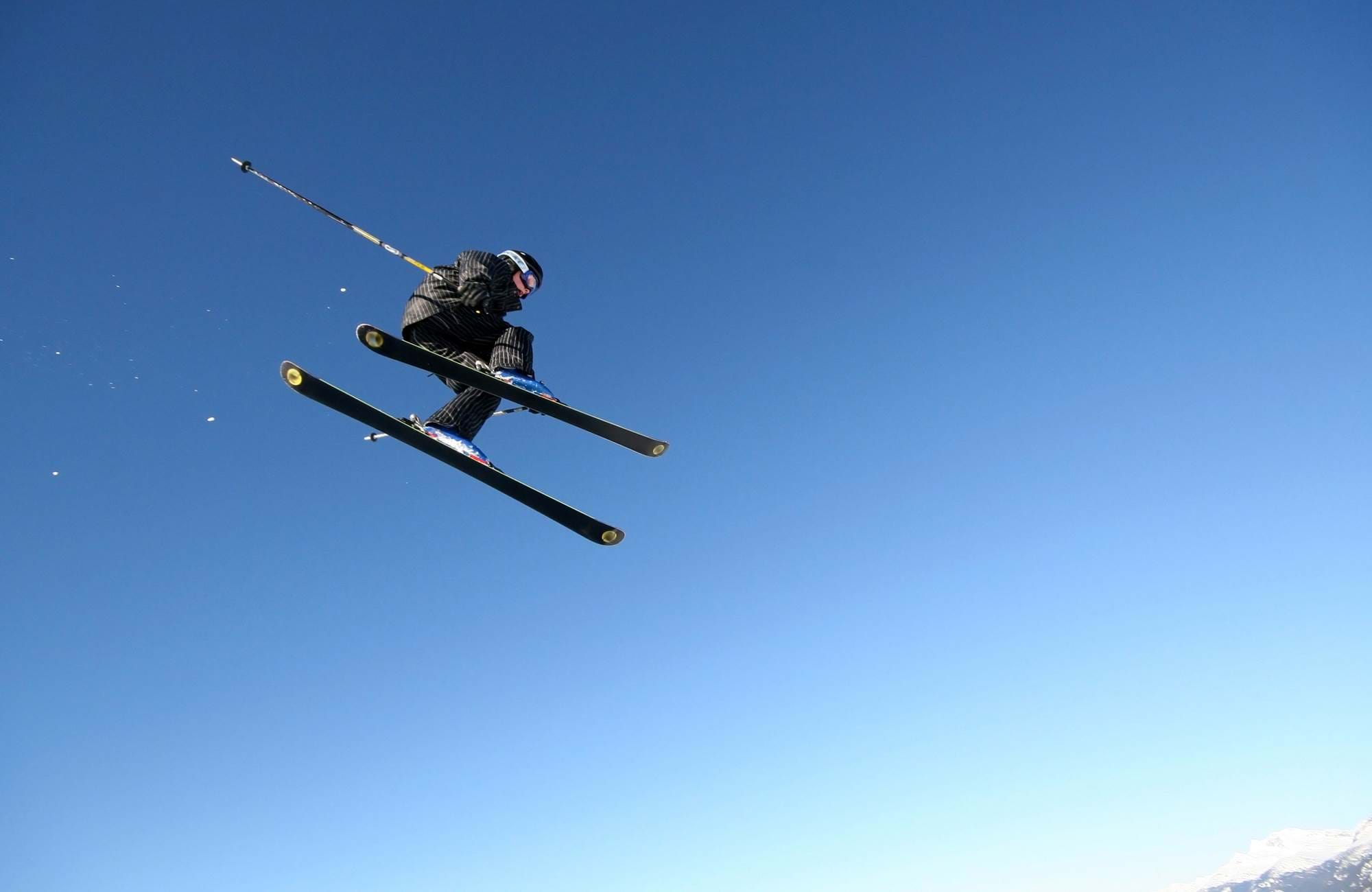 skiier flying up in the air in Canada near Kamloops
