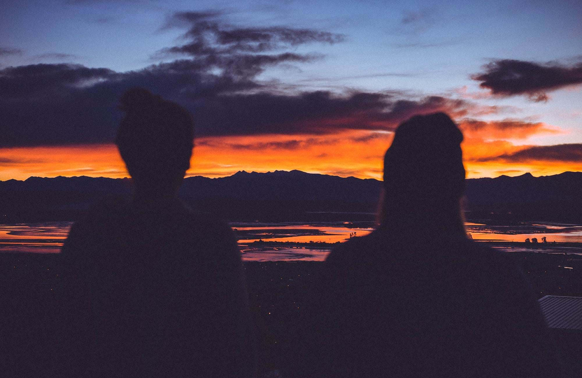 two students during sunset in new zealand
