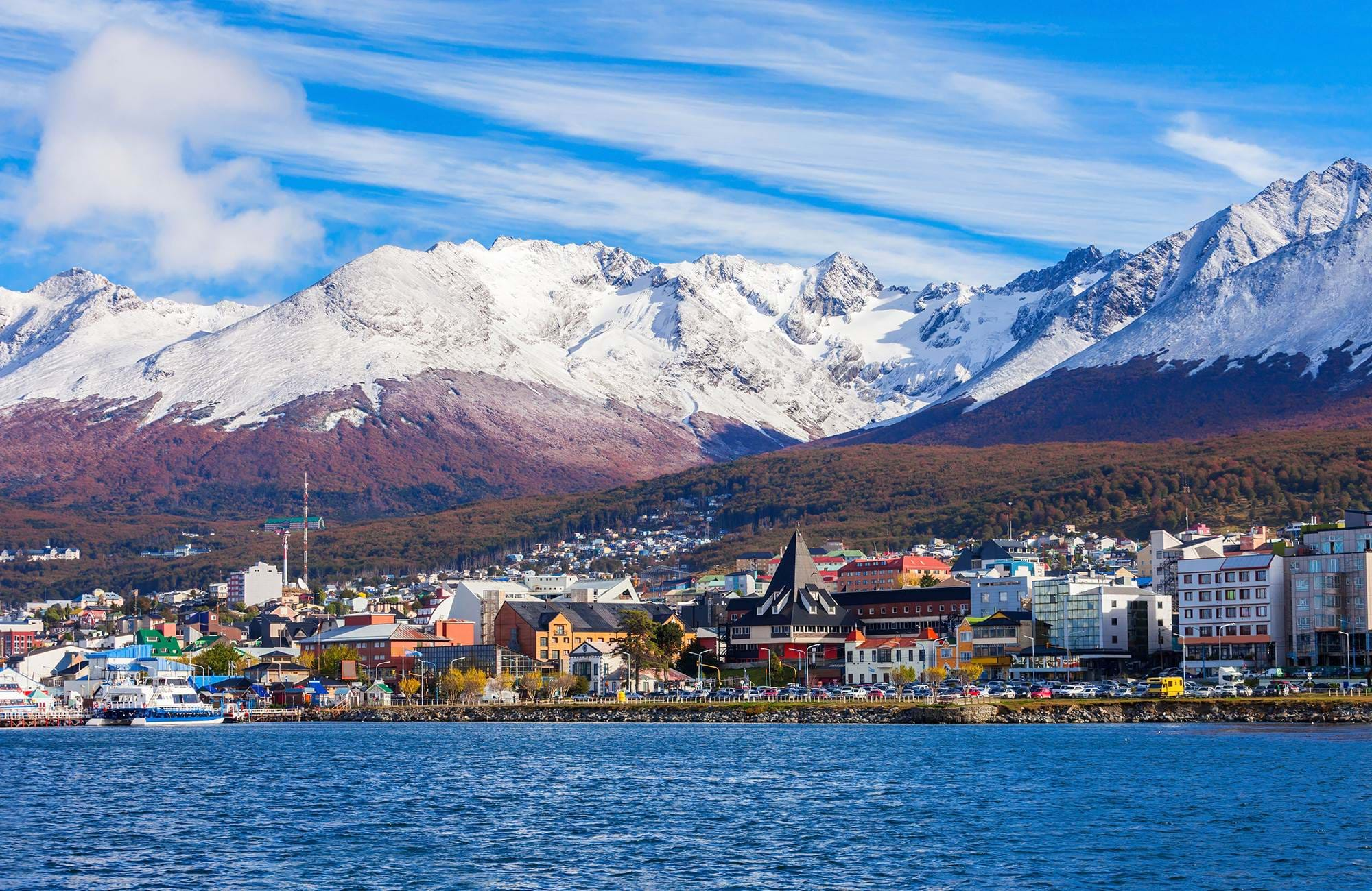 View of the city Ushuaia from the sea with mountains in the background, Argentina