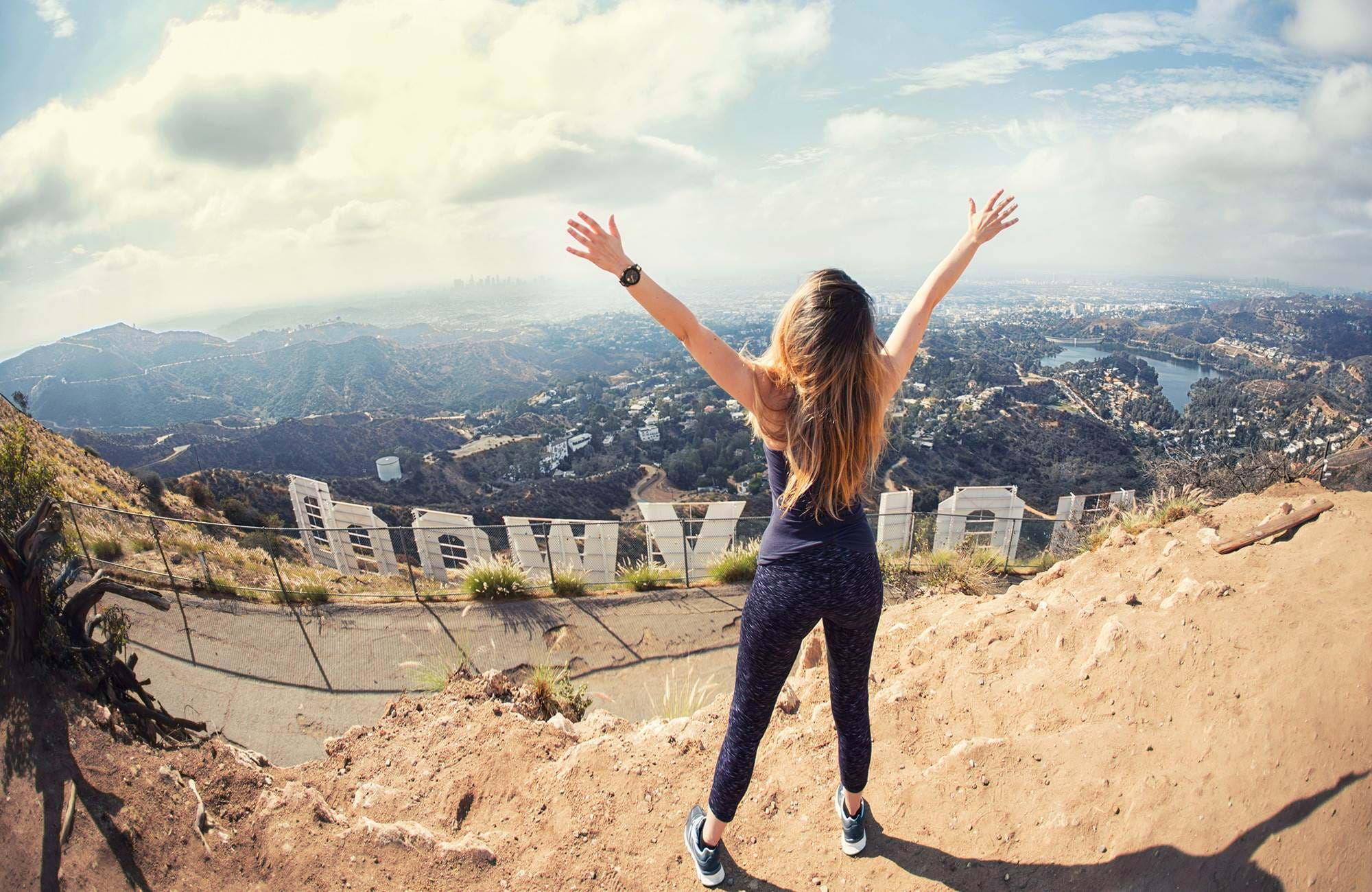 A female student in Hollywood at the Hollywood sign