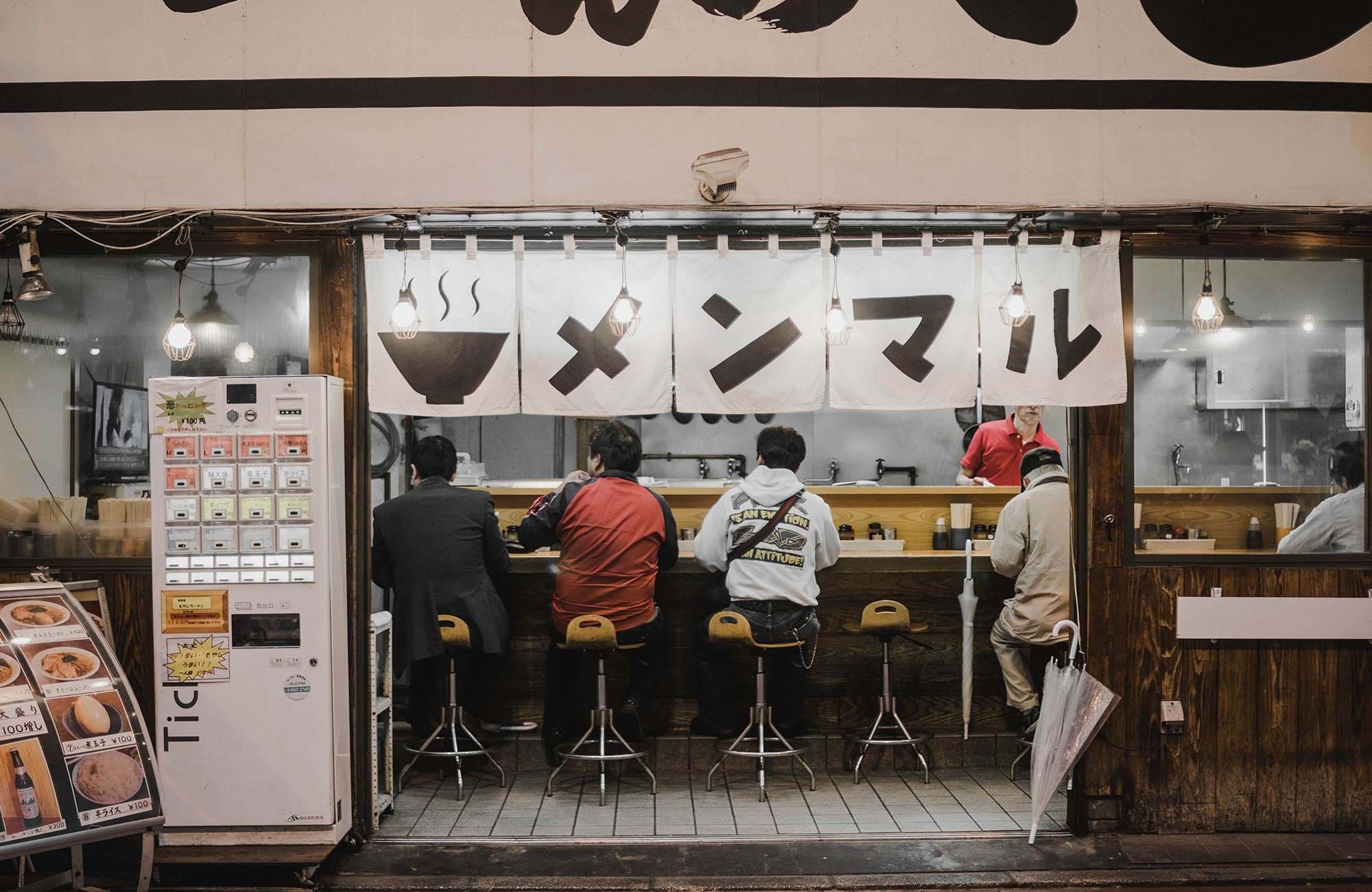 japan-men-eating-in-cozy-restaurant
