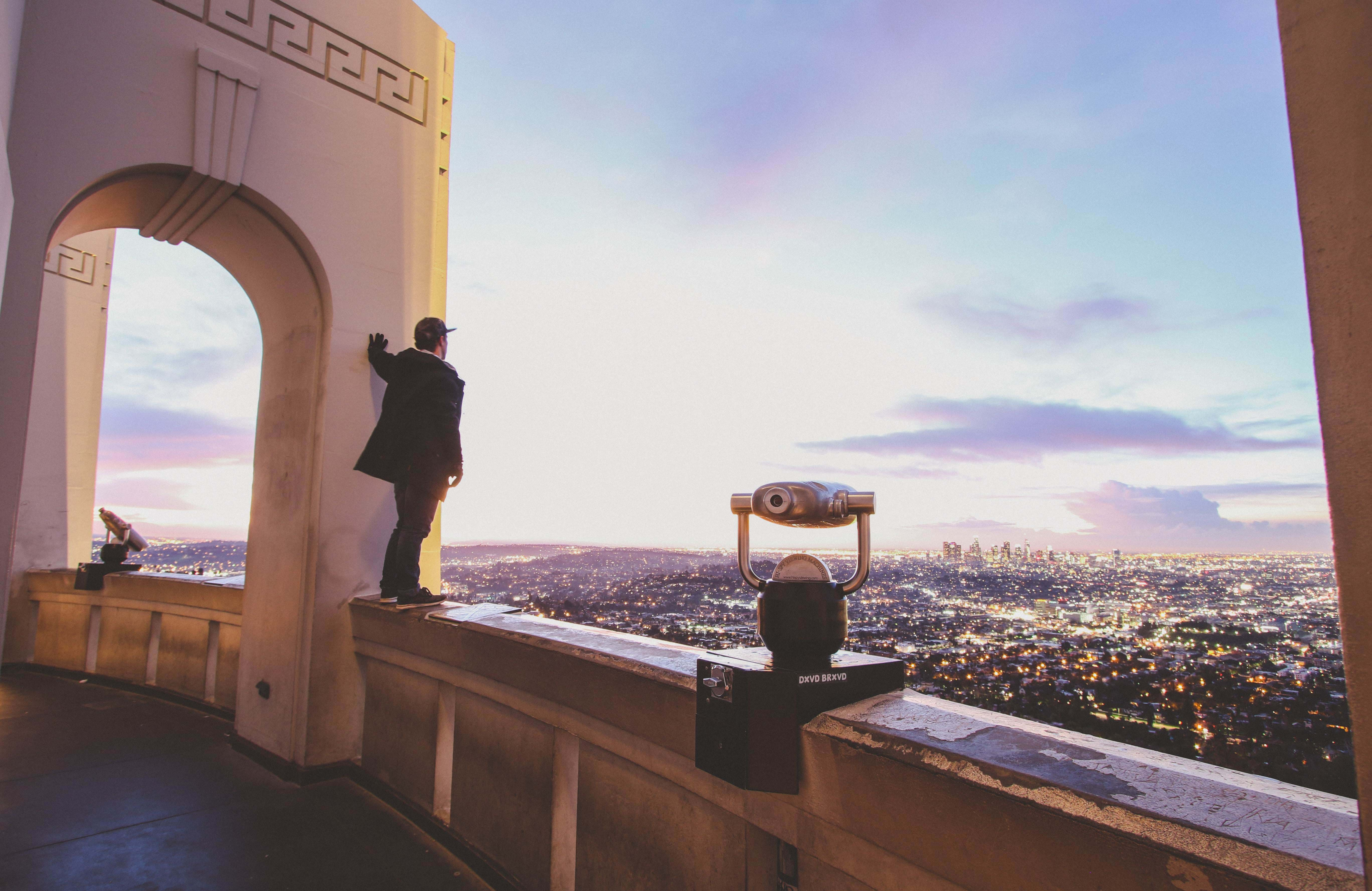 A student in Los Angeles overlooking the LA skyline