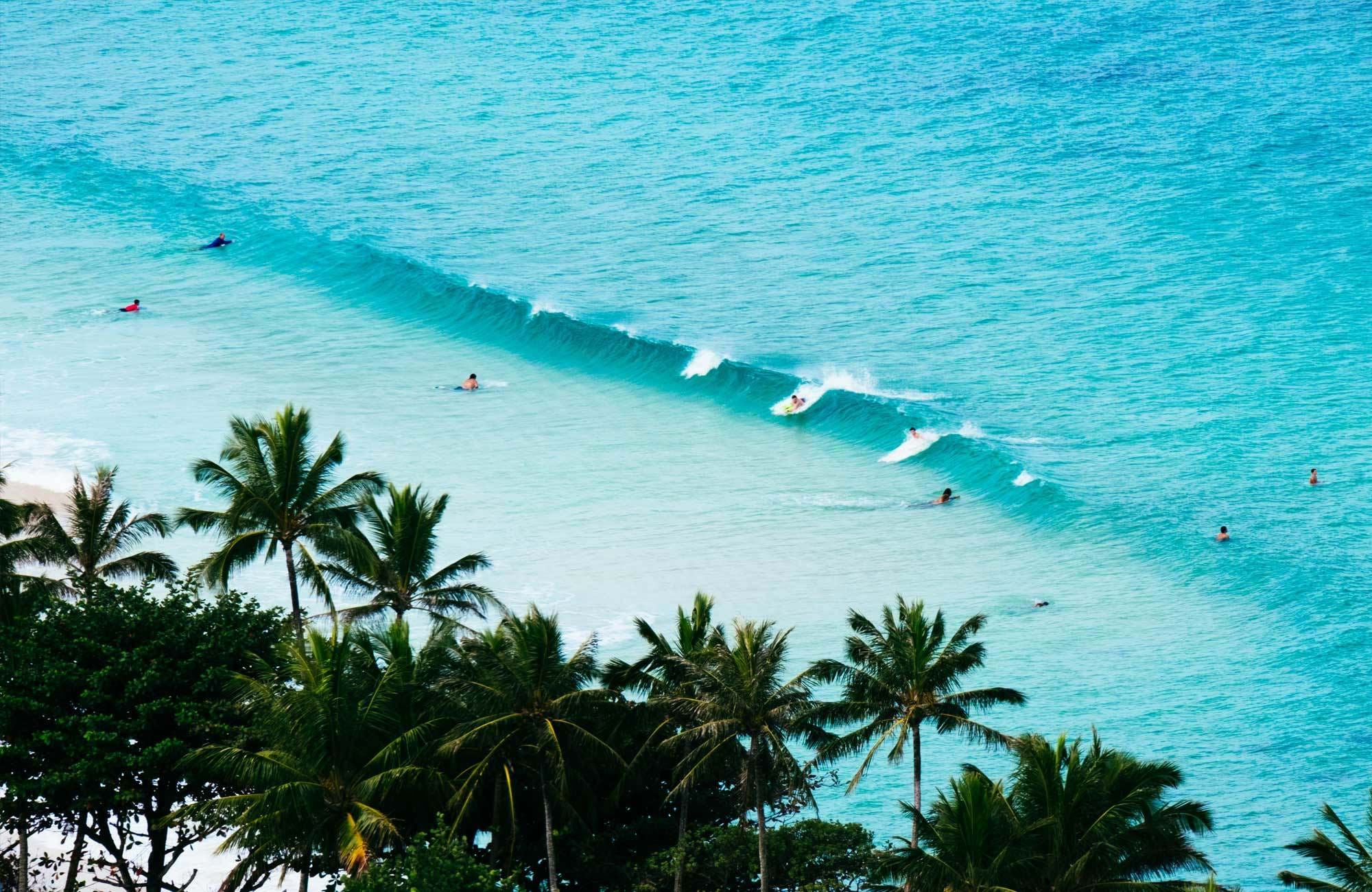 Surfers waiting for long soft waves and great swell in Panama, Central America