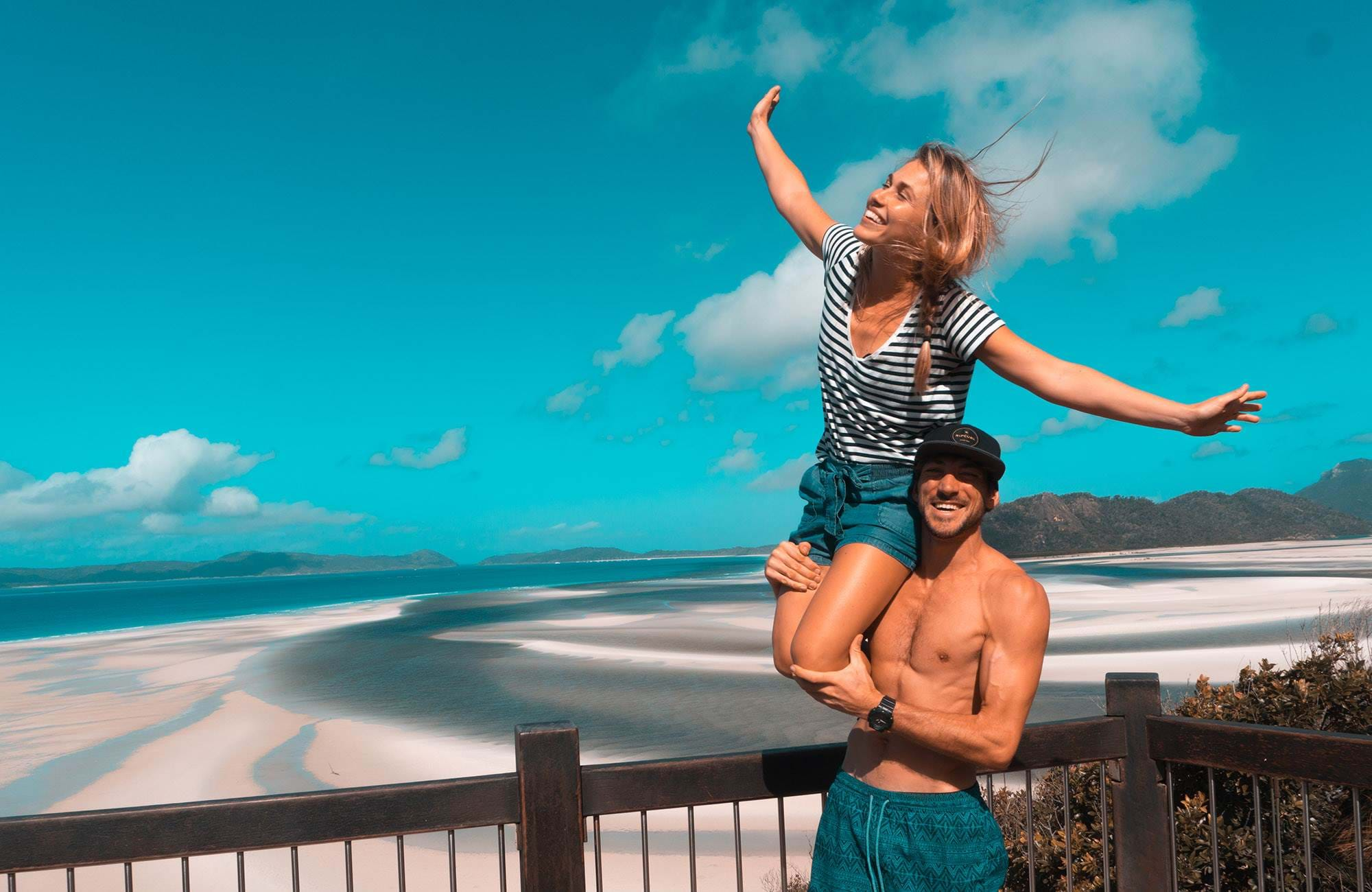 young couple having the time of their lives on the beach while studying in australia