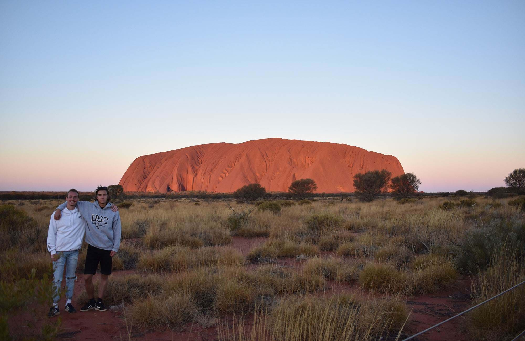 oliver and friend at uluru, ayers rock in australia